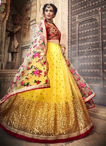 Yellow Net Wedding Wear Sequins Work Lehenga Choli