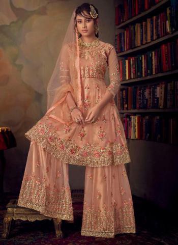 Bridal Wear Peach Heavy Embroidery Work Net Sharara Suit