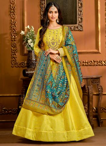 Party Wear Yellow Butti Work Tapeta Silk Gown With Dupatta