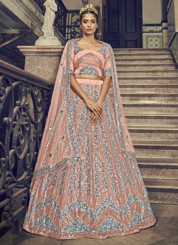 Wedding Wear Peach Sequins Work Net Lehenga Choli
