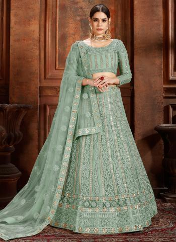 Bridal Wear Pista Green Net Thread Work Lehenga Choli