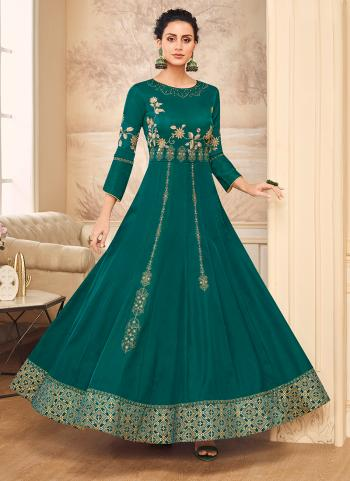 Party Wear Green Muslin Satin Embroidery Work Gown